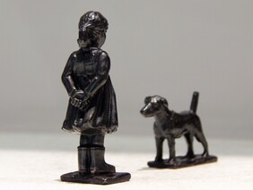 'Girl and Dog' bronze sculpture by Aaron Brown