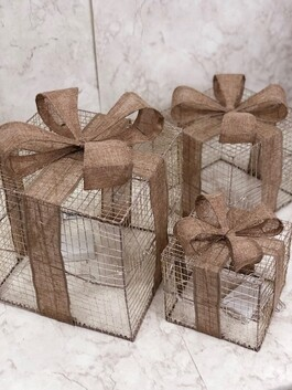 Large Gold String Present with Hessian Bow