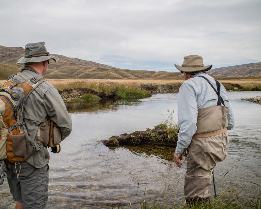 New Zealand Fly fishing Guide Stalking a rising Brown in the high country of New Zealand  Todd Adolph