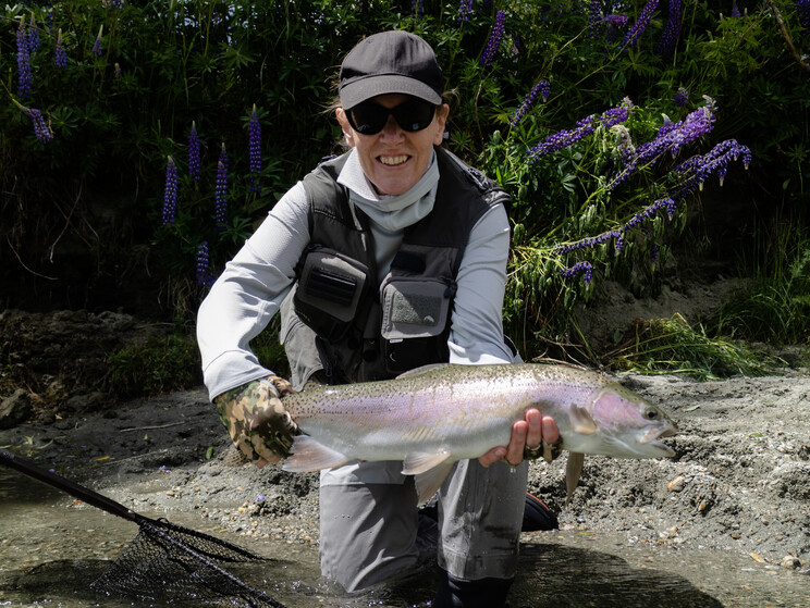 Karen with a well-conditioned wild rainbow trout, from a late spring trip south to the Otago region. Todd Adolph