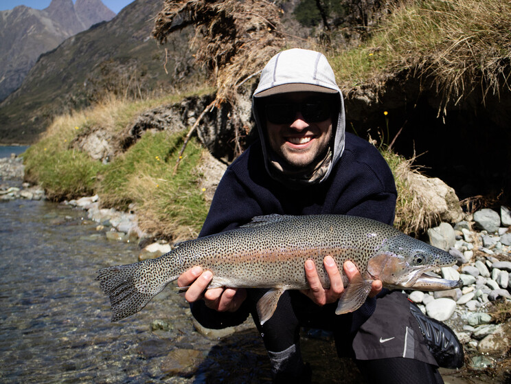 Holden displays a stunningly marked wild rainbow trout from the South Island of New Zealand. Todd Adolph