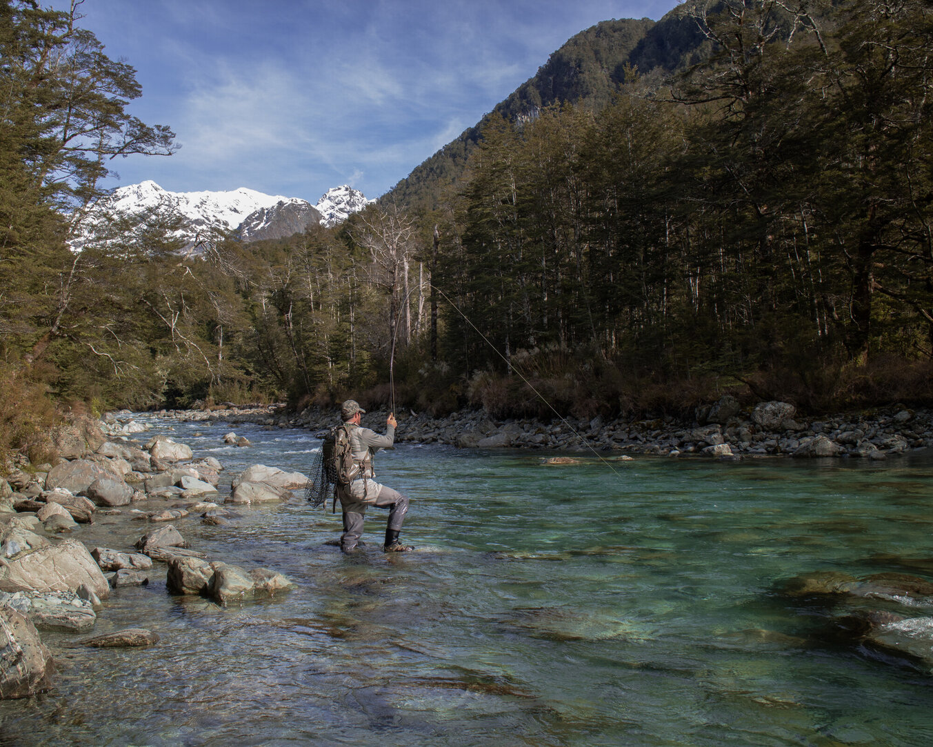 Hooked on a trophy brown trout New Zealand back country  Todd Adolph