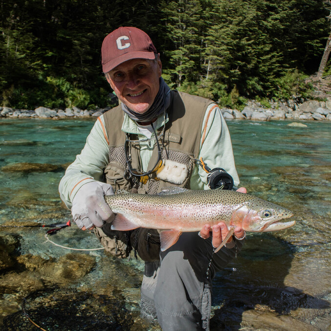 Tom McCabe with a delightful Rainbow trout from the backcountry of New Zealand. Todd Adolph