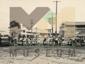 Photo - Children on the model train on the temporary site on the corner of Thames and Lorne Street