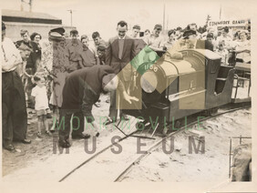 Photo - Wilf Rushton driving the peg in the model railway set up in Thames Street